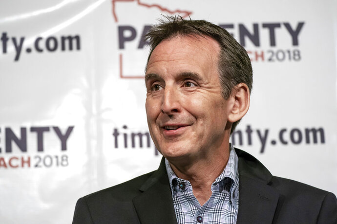 """FILE - In this Thursday, May 31, 2018, file photo, former Minnesota Gov. Tim Pawlenty speaks at a news conference in St. Paul, Minn. U.S. President Donald Trump is heading to Minnesota to stump for a congressional candidate, but another test of GOP loyalty to the president looms large over his visit. Minnesota's Republican primary for governor provides the latest test case. It features a strong Trump supporter going up against Pawlenty, who called Trump """"unhinged"""" at one point during the 2016 campaign. Pawlenty says now that he voted for Trump and supports his policies. (Glen Stubbe/Star Tribune via AP, File)"""
