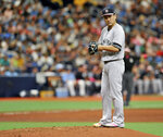 New York Yankees starter Mashiro Tanaka looks toward first base after giving up a single to Tampa Bay Rays' Ji-Man Choi during the sixth inning of a baseball game Sunday, May 12, 2019, in St. Petersburg, Fla. (AP Photo/Steve Nesius)