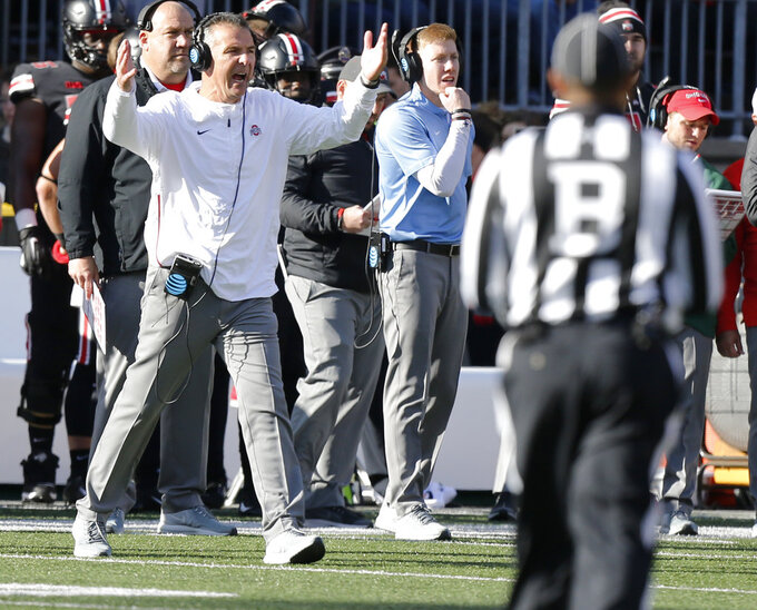 Ohio State head coach Urban Meyer shouts to his team during the second half of an NCAA college football game against Nebraska, Saturday, Nov. 3, 2018, in Columbus, Ohio. Ohio State beat Nebraska 36-31. (AP Photo/Jay LaPrete)