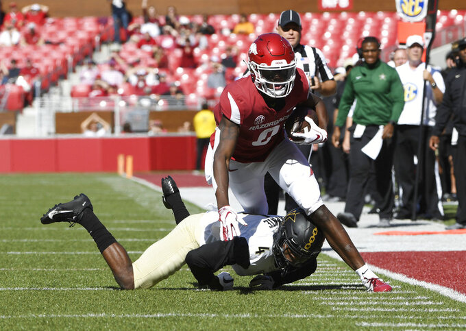 Arkansas receiver Michael Woods is knocked out of bounds by Vanderbilt defender Randall Haynie in the second half of an NCAA college football game Saturday, Oct. 27, 2018, in Fayetteville, Ark. (AP Photo/Michael Woods)