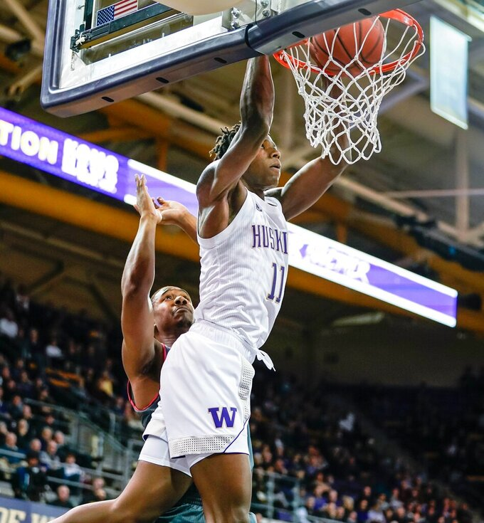 Washington's Nahziah Carter dunks against Eastern Washington during the first half of an NCAA college basketball game Wednesday, Dec. 4, 2019, in Seattle. (Dean Rutz/The Seattle Times via AP)