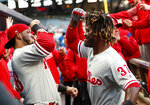 Philadelphia Phillies' Odubel Herrera (37) celebrates in the dugout with Jorge Alfaro (38) after hitting a solo-home run in the first inning of a baseball game against the Atlanta Braves Monday, April 16, 2018, in Atlanta. (AP Photo/John Bazemore)