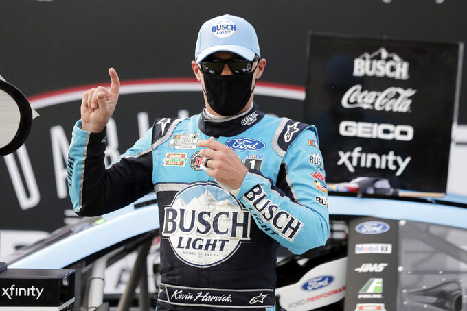 Kevin Harvick celebrates after winning the NASCAR Cup Series auto race Sunday, May 17, 2020, in Darlington, S.C. (AP Photo/Brynn Anderson)