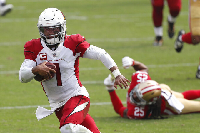 Arizona Cardinals quarterback Kyler Murray (1) runs past San Francisco 49ers cornerback Richard Sherman (25) to score a touchdown during the second half of an NFL football game in Santa Clara, Calif., Sunday, Sept. 13, 2020. (AP Photo/Josie Lepe)