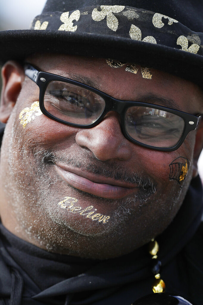 New Orleans Saints fan Raydell Hayes smiles before the NFL football NFC championship game against the Los Angeles Rams Sunday, Jan. 20, 2019, in New Orleans. (AP Photo/David J. Phillip)