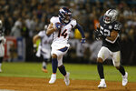 Denver Broncos wide receiver Courtland Sutton runs with the ball past Oakland Raiders middle linebacker Marquel Lee (52) during the first half of an NFL football game Monday, Sept. 9, 2019, in Oakland, Calif. (AP Photo/D. Ross Cameron)