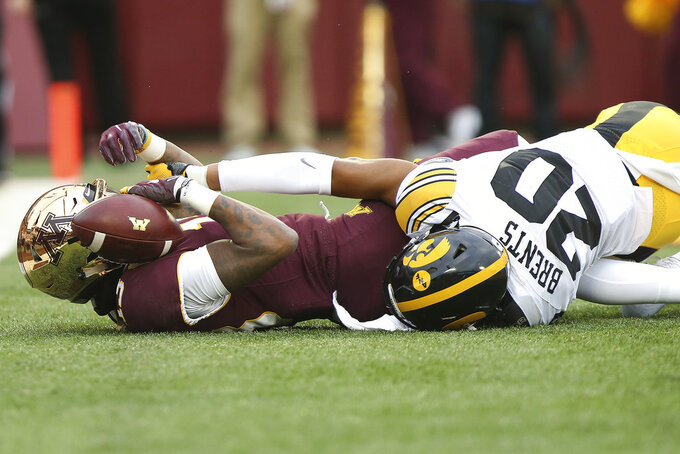 Minnesota wide receiver Rashod Bateman holds onto the ball in end zone after scoring a touchdown against Iowa's Julius Brents during an NCAA college football game Saturday, Oct. 6, 2018, in Minneapolis. Iowa won 48-31. (AP Photo/Stacy Bengs)