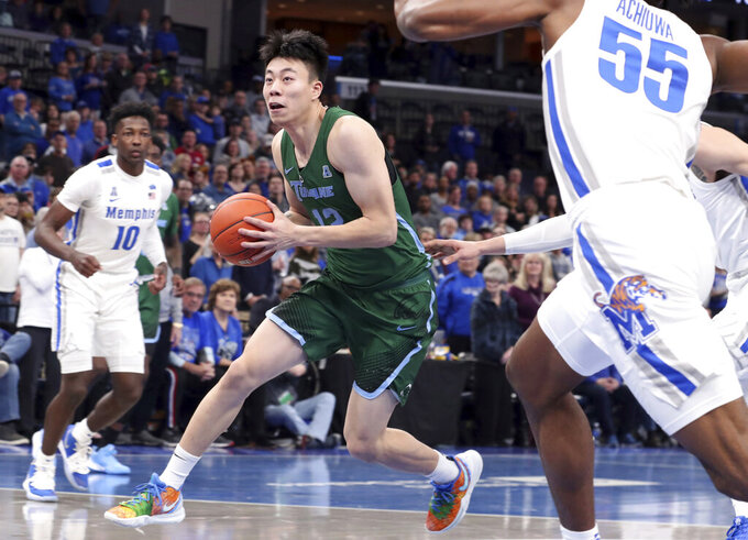 Tulane guard Kevin Zhang (12) heads to the basket in the first half of an NCAA college basketball game against Memphis, Monday, Dec. 30, 2019, in Memphis, Tenn. (AP Photo/Karen Pulfer Focht)