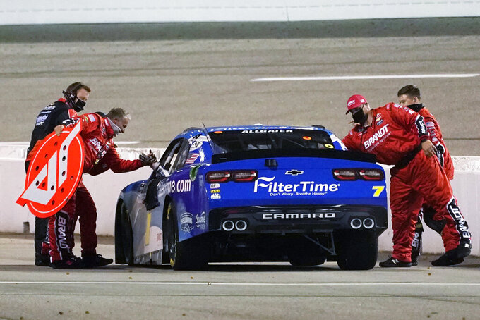 Justin Allgaier (7) greets his pit crew as he celebrates after winning a NASCAR Xfinity Series auto race Friday, Sept. 11, 2020, in Richmond, Va. (AP Photo/Steve Helber)
