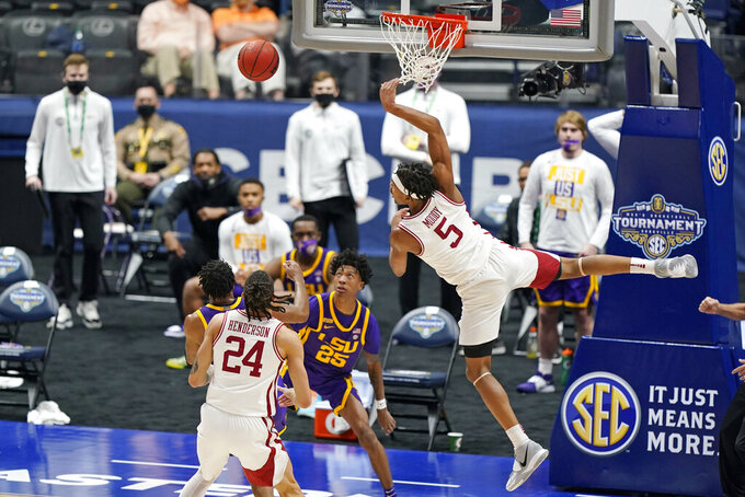 Arkansas' Moses Moody (5) misses a shot against LSU in the first half of an NCAA college basketball game in the Southeastern Conference Tournament Saturday, March 13, 2021, in Nashville, Tenn. (AP Photo/Mark Humphrey)