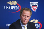 "FILE - In this Sept. 3, 2014, file photo, Patrick McEnroe speaks during a news conference at the U.S. Open tennis tournament in New York. Former U.S. Davis Cup captain Patrick McEnroe says in a video posted on social media that he tested positive for the coronavirus. McEnroe, younger brother of eight-time major champion John, said he did a drive-through test in upstate New York after developing what he called ""minor symptoms"" about 10 days ago. Patrick McEnroe said: ""The good news is I feel fine. My symptoms have passed. I feel, really, 100 percent."" (AP Photo/John Minchillo, File)"