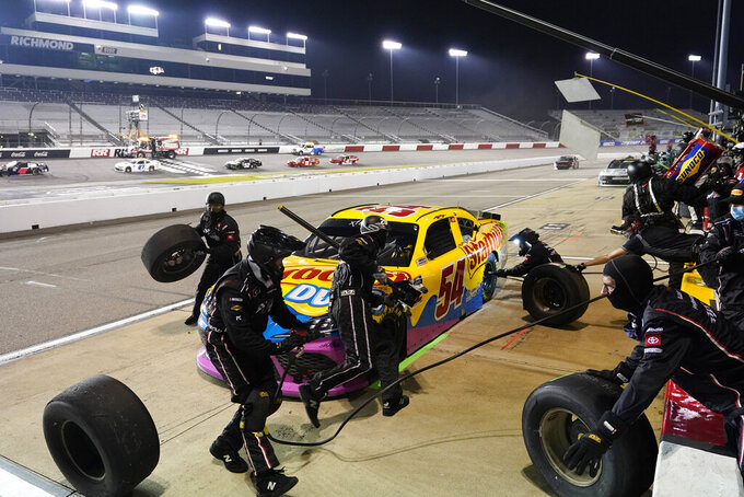 Kyle Busch makes a pit stop during the NASCAR Xfinity Series auto race Friday, Sept. 11, 2020, in Richmond, Va. (AP Photo/Steve Helber)