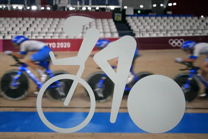 Members of the Italian men's track cycling team round the track during a training session inside the Izu velodrome at the 2020 Summer Olympics, Thursday, July 29, 2021, in Tokyo, Japan. (AP Photo/Christophe Ena)