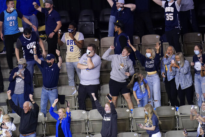 Oral Roberts fans celebrate after a college basketball game against Florida in the second round of the NCAA tournament at Indiana Farmers Coliseum, Sunday, March 21, 2021 in Indianapolis. Oral Roberts won 81-78. (AP Photo/AJ Mast)