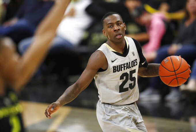File--In this Saturday, Feb. 2, 2019, file photograph, Colorado guard McKinley Wright IV looks to pass the ball in the second half of an NCAA basketball game against Oregon in Boulder, Colo. (AP Photo/David Zalubowski, File)