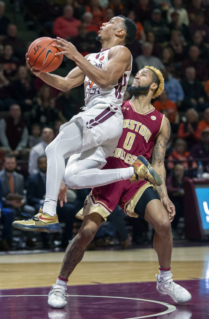 Virginia Tech guard Justin Robinson (5) goes up for a basket against Boston College guard Ky Bowman (0) during the second half of an NCAA college basketball game Saturday, Jan. 5, 2019, in Blacksburg, Va. Tech won 77-66. (AP Photo/Don Petersen)