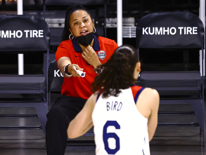 U.S. coach Dawn Staley talks with guard Sue Bird before the team's pre-Olympic exhibition basketball game against Nigeria in Las Vegas on Sunday, July 18, 2021. (Chase Stevens/Las Vegas Review-Journal via AP)