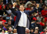 FILE - In this March 12, 2019, file photo, Los Angeles Lakers coach Luke Walton gestures to players during the second half against of the team's NBA basketball game against the Chicago Bulls, in Chicago. The Sacramento Kings have hired Luke Walton as their coach just days after he parted ways with the Los Angeles Lakers following three losing seasons. The Kings announced Monday, April 15, 2019, that Walton will replace Dave Joerger.(AP Photo/Nuccio DiNuzzo, File)
