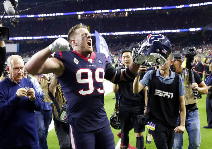 Houston Texans defensive end J.J. Watt (99) celebrates with fans after an NFL wild-card playoff football game against the Buffalo Bills Saturday, Jan. 4, 2020, in Houston. The Texans won 22-19 in overtime.(AP Photo/Michael Wyke)