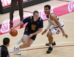 California forward Grant Anticevich (15) drives past Stanford forward Oscar da Silva (13) during the second half of an NCAA college basketball game in Stanford, Calif., Sunday, Feb. 7, 2021. (AP Photo/Tony Avelar)