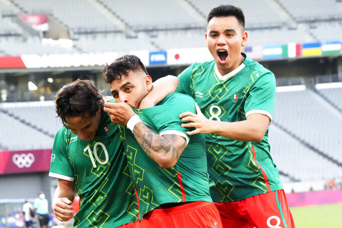 Mexico's Alexis Vega, center, celebrates his goal with teammates Carlos Rodriguez, right, and Diego Lainez during a men's soccer match against France at the 2020 Summer Olympics, Thursday, July 22, 2021, in Tokyo, Japan. (AP Photo/Shuji Kajiyama)