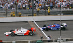 FILE - In this May 28, 2006, file photo, Sam Hornish Jr., left, pumps his fist as he beats Marco Andretti to the finish line to win the Indianapolis 500 auto race at Indianapolis Motor Speedway in Indianapolis. The Associated Press has updated its survey of living Indianapolis 500 winners and their pick as the greatest race in the long history of the event. There are six races that received multiple votes, topped by Al Unser Jr.'s victory over Scott Goodyear in 1992 — the closest Indy 500 in history. The others are Emerson Fittipaldi's win in 1989; Hornish's win in 2006; the 1982 battle between Rick Mears and Gordon Johncock; the 2011 race won by the late Dan Wheldon; and the 2014 thriller won by Ryan Hunter-Reay. (AP Photo/Dave Parker, File)
