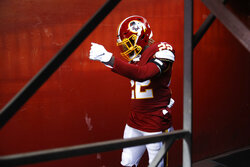Washington Redskins defensive back Deshazor Everett heads to the field to work out prior to an NFL football game against the Detroit Lions, Sunday, Nov. 24, 2019, in Landover, Md. (AP Photo/Patrick Semansky)