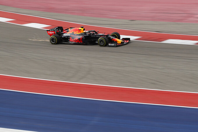 Red Bull driver Max Verstappen, of the Netherlands, heads through a turn during the second practice session for the Formula One U.S. Grand Prix auto race at Circuit of the Americas, Friday, Nov. 1, 2019, in Austin, Texas. (AP Photo/Eric Gay)
