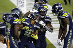 Seattle Seahawks wide receiver Freddie Swain center, celebrates with teammates, including wide receiver DK Metcalf, right, after Swain scored a touchdown against the New England Patriots during the second half of an NFL football game, Sunday, Sept. 20, 2020, in Seattle. (AP Photo/Elaine Thompson)