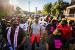 NBA star and current Winston-Salem State University student Chris Paul leads a march to vote at the early voting center at the Anderson Center on Tuesday, Oct. 27, 2020, in Winston-Salem, N.C. (Andrew Dye/The Winston-Salem Journal via AP)