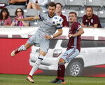 Chicago Fire forward Luis Solignac, left, pursues the ball with Colorado Rapids defender Deklan Wynne during the first half of an MLS soccer match Wednesday, June 13, 2018, in Commerce City, Colo. (AP Photo/David Zalubowski)
