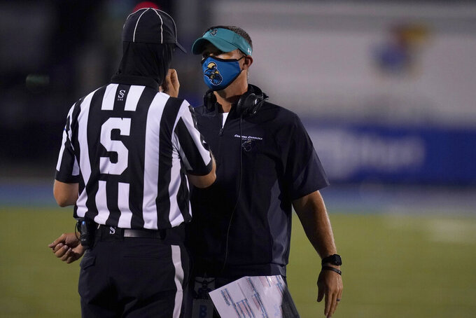 Coastal Carolina head coach Jamey Chadwell talks with a game official during the second half of an NCAA college football game against Kansas in Lawrence, Kan., Sunday, Sept. 13, 2020. Coastal Carolina defeated Kansas 38-23. (AP Photo/Orlin Wagner)