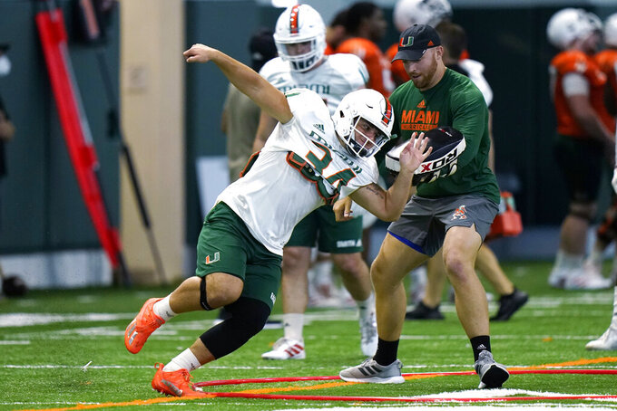 Miami linebacker Ryan Ragone (34) goes through a drill during NCAA college football practice Tuesday, Aug. 10, 2021, in Coral Gables, Fla. (AP Photo/Lynne Sladky)
