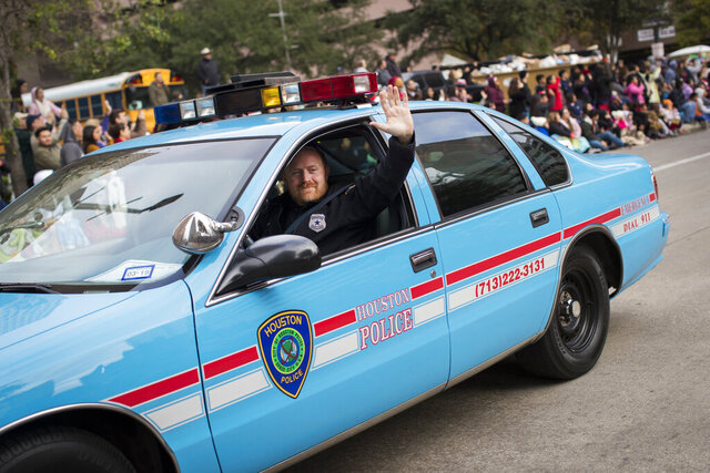CORRECTS DATE OF PHOTO TO THURSDAY, NOV. 22, 2018, INSTEAD OF NOV. 21, 2020, AND CORRECTS BYLINE TO MARIE D. DE JESÚS INSTEAD OF STEVE GONZALES - This Thursday, Nov. 22, 2018, photo shows Houston police Officer Jason Knox in a restored HPD cruiser during the H-E-B Thanksgiving Day Parade in Houston. The Houston police department tweeted that Knox, a Tactical Flight Officer, was killed when a police helicopter crashed early Saturday, May 2, 2020, in Houston. (Marie D. De Jesús/Houston Chronicle via AP)