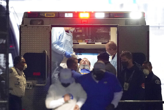 Los Angeles Rams quarterback John Wolford leans back after walking into an ambulance parked in a tunnel just off the field during the first half of an NFL wild-card playoff football game against the Seattle Seahawks, Saturday, Jan. 9, 2021, in Seattle. (AP Photo/Ted S. Warren)