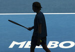 Russia's Andrey Rublev prepares to serve to Norway's Casper Ruud during their fourth round match at the Australian Open tennis championships in Melbourne, Australia, Monday, Feb. 15, 2021. (AP Photo/Hamish Blair)