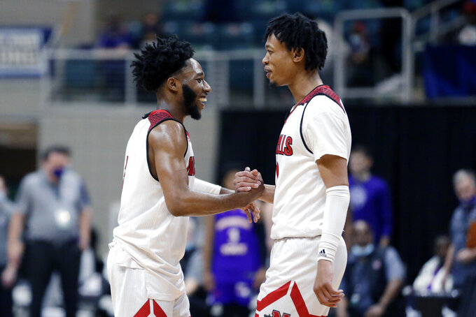 Nicholls State guards Kevin Johnson (3) and Jeremiah Buford (11) celebrate the team's win against Northwestern State in an NCAA college basketball game in the Southland Conference semifinals Friday, March 12, 2021, in Katy, Texas. (AP Photo/Michael Wyke)