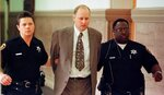 FILE - In this May 6, 1999 file photo, Allegheny County Sheriff's deputies lead Timothy Boczkowski from the courtroom where a jury that had previously convicted him of first-degree murder in the November 1994 strangling death of Maryann Boczkowski. North Carolina's parole commission said Wednesday, Nov. 7, 2018,  it was collecting information ahead of a decision on whether to release Boczkowski. He also faces a life sentence in Pennsylvania and North Carolina state prison officials said he would be sent there if he is paroled in North Carolina after a hearing which could come as early as next month.  (AP Photo/Keith Srakocic)