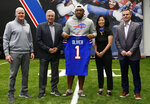 Buffalo Bills first-round draft pick Ed Oliver, center, poses with, from left to right, head coach Sean Mcdermott, owner Terry Pegula, owner/president Kim Pegula and general manager Brandon Beane pose for photographs following an NFL football news conference Friday, April 27, 2019, in Orchard Park N.Y. (AP Photo/Jeffrey T. Barnes)