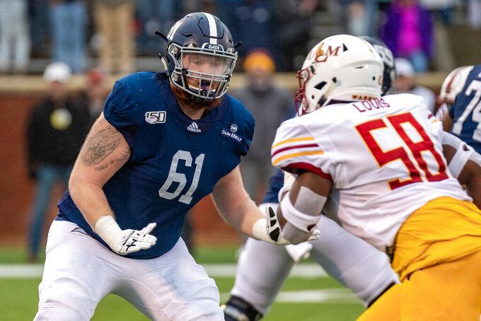 In this Nov. 16, 2019 photo, provided by Georgia Southern Athletics, Georgia Southern offensive lineman Drew Wilson blocks against Louisiana-Monroe during an NCAA college football game in Statesboro, Ga. Wilson, Oregon State quarterback Jake Luton and Salisbury State receiver Octavion Wilson are college football's Comeback Players of the Year(Georgia Southern Athletics via AP)