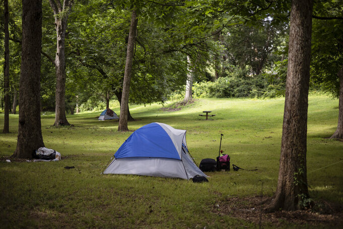 Tents belonging to those without permanent housing are set up in North Oconee River Park in Athens, Ga., on Monday, July 12, 2021 (Kayla Renie /Athens Banner-Herald via AP)