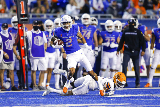 Boise State wide receiver Khalil Shakir (2) spins away from the tackle attempt by UTEP cornerback Torey Richardson (8) for a 36-yard reception during the first half of an NCAA college football game Friday, Sept. 10, 2021, in Boise, Idaho. (AP Photo/Steve Conner)