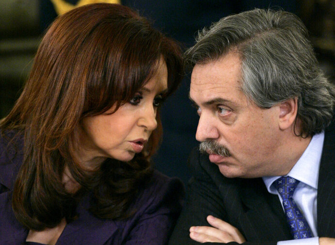FILE - In this March 31, 2008 file photo, Argentina's President Cristina Fernandez, left, talks to her Chief of Cabinet, Alberto Fernandez, during a meeting at the presidential palace in Buenos Aires. Cristina Fernandez announced on Saturday her candidacy for vice president in October's general elections on Saturday, May 18, 2019, and that Alberto Fernández will run for the presidency against conservative President Mauricio Macri.  (AP Photo/Natacha Pisarenko, File)