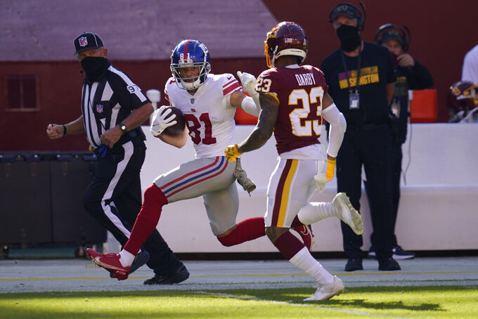 New York Giants wide receiver Austin Mack (81) runs down field against Washington Football Team cornerback Ronald Darby (23) in the first half of an NFL football game between the New York Giants and Washington Football Team, Sunday, Nov. 8, 2020, in Landover, Md. (AP Photo/Patrick Semansky)