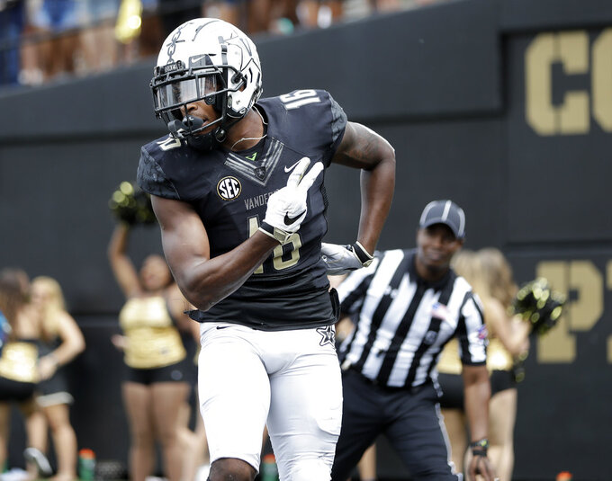 Vanderbilt wide receiver Kalija Lipscomb celebrates after scoring a touchdown on an 11-yard pass against Nevada in the second half of an NCAA college football game Saturday, Sept. 8, 2018, in Nashville, Tenn. (AP Photo/Mark Humphrey)