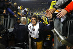 Michigan quarterback Shea Patterson walks to the locker room after an NCAA college football game against Notre Dame in Ann Arbor, Mich., Saturday, Oct. 26, 2019. (AP Photo/Paul Sancya)