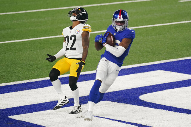 New York Giants wide receiver Darius Slayton (86) scores a touchdown against Pittsburgh Steelers cornerback Steven Nelson (22) during the fourth quarter of an NFL football game Monday, Sept. 14, 2020, in East Rutherford, N.J. (AP Photo/Seth Wenig)