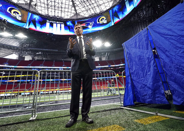 FILE - In this Tuesday, Jan. 29, 2019 file photo, NFL Chief Medical Officer Dr. Allen Sills explains what takes place inside a sideline injury tent, right, during a health and safety tour at Mercedes-Benz Stadium for the NFL Super Bowl 53 football game in Atlanta.  Everyone who has watched an NFL player disappear into that medical tent on a sideline has an idea of what happens once the flap folds down. The NFL shares a look Tuesday, Jan. 28, 2020 inside the tent and game-day procedures designed to help when someone is hurt. (AP Photo/David J. Phillip, File)