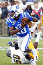 Duke's Quentin Harris (18) pulls away from North Carolina A&T's Devin Harrell (50) during the first half of an NCAA college football game in Durham, N.C., Saturday, Sept. 7, 2019. (AP Photo/Karl B DeBlaker)