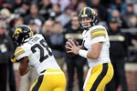 Iowa quarterback Nate Stanley (4) drops back behind running back Toren Young (28) while playing against Purdue in the second half of an NCAA college football game in West Lafayette, Ind., Saturday, Nov. 3, 2018. (AP Photo/AJ Mast)